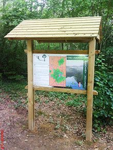 Sheltered map panels in the forest